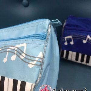 túi xách và hộp bút âm nhạc